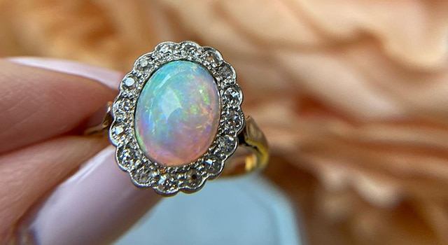 Opal engagement ring with diamond halo